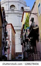 February 10th, 2018- Lisboa, Portugal: The church of Santa Engrácia (National Pantheon) showing behind a row of traditional houses in Lisboa, Portugal