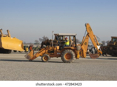 February 11, 2011 - Tulare, CA, USA: A backhoe loader at a California heavy equipment auction.