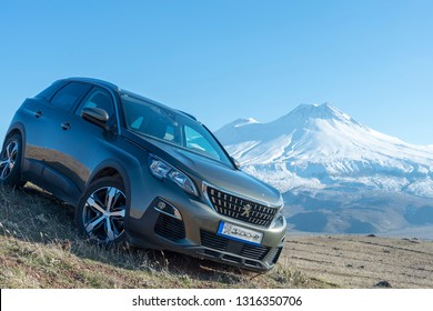 FEBRUARY 12,2019 TURKEY.The SUV Peugeot 3008 with the snowy mountain background.