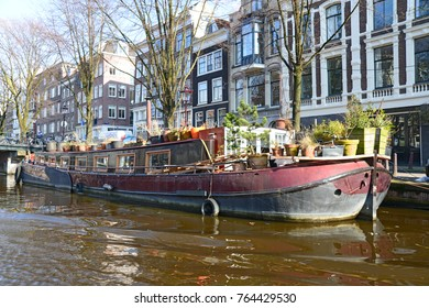 FEBRUARY 13,2013 AMSTERDAM.Amsterdam is the capital and most populous municipality of the Netherlands.Its famous canal and boats are shown.