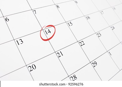 February 14th marked out on a calendar with a red ring around the date