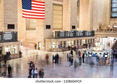 February 17, 2018: Inside of Grand Central Station, NY, long exposure image with people walking through building below.