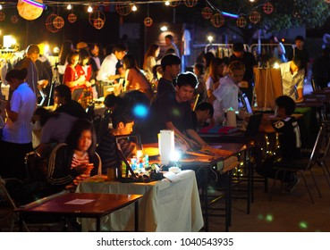 February 17, 2018 young people visit and go shopping around the annually design students' evening traditional hand crafts demonstration crafts market in KHON KAEN University, THAILAND