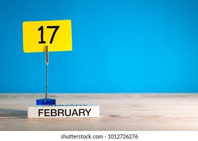 February 17th. Day 17 of february month, calendar on little tag at blue background. Winter time. Empty space for text, mockup