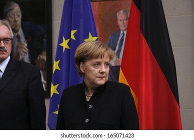 FEBRUARY 18, 2008 - BERLIN: German Chancellor Angela Merkel (in the background a painting portrait of her predecessor, Willy Brandt) during a reception in the Chanclery in Berlin.