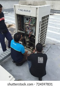 February, 18, 2017. Penang, MALAYSIA. Aircondition vendor try to fix VRV pcb board controller burn at building rooftop.