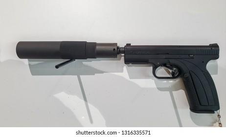 February 18, 2019 - Abu Dhabi, UAE: Caracal UAE made Pistol with silencer at IDEX 2019 Display