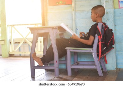 FEBRUARY 20, 2016 - Surin, THAILAND:Asian rural student Working At Desk In uniform student in School classroom of Thailand, exam student background and education concept