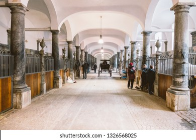 February 20, 2019. The Royal Stable in Denmark is the city of Copenhagen in the territory of Christiansborg Slot. Old stable with white horses in stalls.