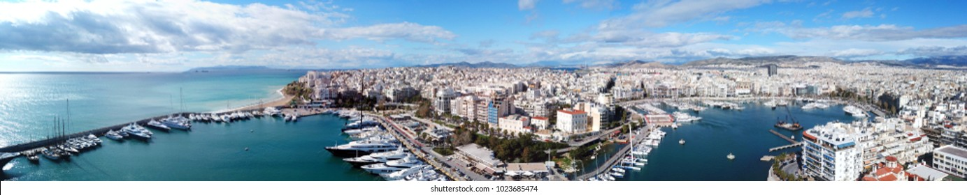 February 2015: Aerial drone bird's eye view panoramic photo of iconic port of Marina Zeas with boats docked next to port of Piraeus, Attica, Greece