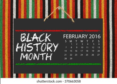 February 2016 Calendar Black History Month Blackboard hanging on striped background