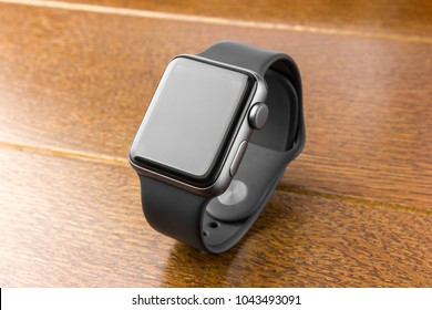 February 2018. Apple Watch Series 3 on a wooden table. A new watch from the APPLE company, close-up on a wooden surface.