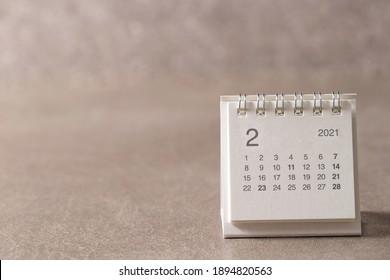 February 2021 calendar on gray background