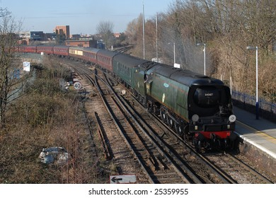 February 21. 2009. Old British Railway steam locomotive Tangmere seen approaching Staines with a charter train.