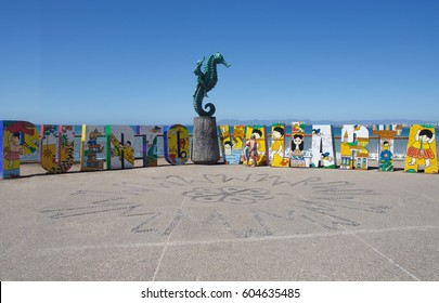 "February 21, 2017: Puerto Vallarta art sculpture on the Malecon boardwalk. Rafael Zamarripa's ""The Boy on the Seahorse"" (Little Seahorse) statue on the Malecón has become a symbol of Puerto Vallarta"