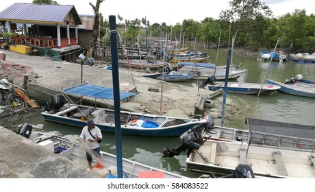 February 21st, 2017 - Klang, MALAYSIA. Fishermen jetty and boats nearby island in Malaysia. Common spot for fishing among villagers and hobbyist here.