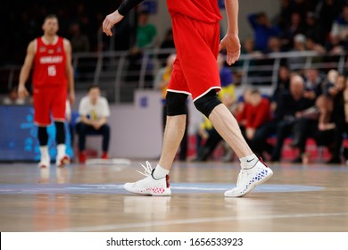 FEBRUARY 23, 2020 - ZAPORIZHIA, UKRAINE: Basketball shoes of walking player on the court with blurred background. Eurobasket 2021 Qualifers. Ukraine-Hungary