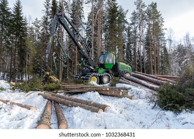 February 24 2018 John Deere harvester in a swedish snowy cold forest