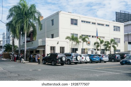 February 24, 2021 Santo Domingo, Dominican Republic. street view image of Haitian embassy in capital city, busy with activity. and Haitian flag in front.