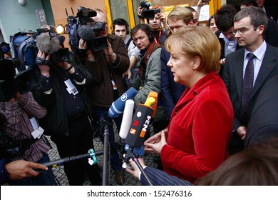 FEBRUARY 26, 2009 - BERLIN: German Chancelor Angela Merkel talks to members of the press after a visit in a housing project for people with AIDS in Berlin-Kreuzberg.