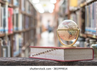 FEBRUARY 26, 2016 - BANGKOK, THAILAND: Library with world globe model on textbook, or dictionary on table in school study class room or university educational resource for knowledge