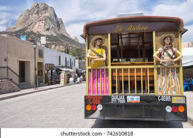 February 26, 2016 Bernal, Queretaro, Mexico: tourist tour bus in the popular destination town with the peak of the large monolith in the background