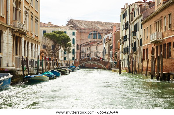 February 26, 2017. Italy, the Venice. A street with boats and a bridge.