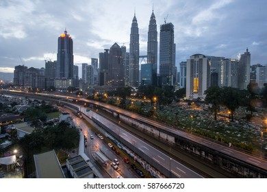 February 26th, 2017 - KUALA LUMPUR, MALAYSIA. A view of Petronas Twin Towers during early morning cloudy sunrise. The twin towers are owned by Petronas Group of Companies.