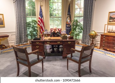 FEBRUARY 28, 2018 - COLLEGE STATION TEXAS - George H.W. Bush Presidential Library and Museum shows Oval Office shows photographer Joe Sohm sitting at Oval Office Desk