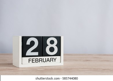 February 28th. Cube calendar for february 28 on wooden table with empty space For text. Not Leap year or intercalary day