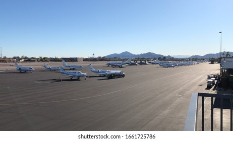 February 3, 2020 - Scottsdale, Arizona / USA: Airplanes parked on the tarmac at  Scottsdale International Airport (SDL) on February 3, 2020.