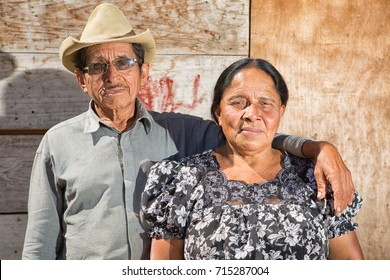 February 4, 2015 San Pedro la Laguna, Guatemala: portrait of a Maya man and woman standing in the front of their house