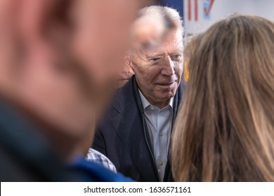 February 4, 2020, Concord, New Hampshire: Candidate Joe Biden is talking to a woman voter after speech at The International Brotherhood of Electrical Workers Local Union 490.