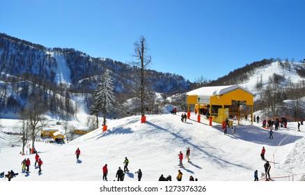 February 5, 2011- Kartepe-Kocaeli-Turkey. People skiing on a sunny day on the mountain.