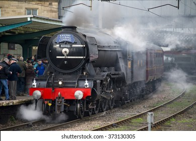 February 6, 2016 Former LNER A3 Pacific steam locomotive 60103 Flying Scotsman minus nameplates in its wartime livery departs Carlisle on its inaugural main line run post rebuild.