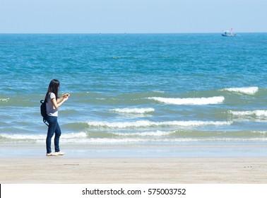February 6, 2017. Traveler.  Relax on the beach. Suansonpradipat Prachuap Khiri Khan Thailand.