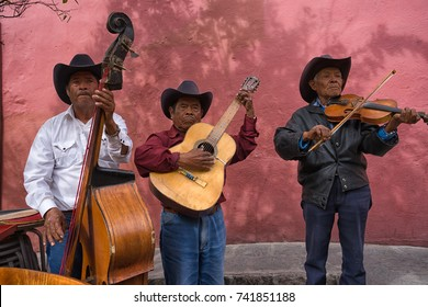 February 7, 2016 San Miguel de Allende, Mexico: street musicians performing at a restaurant patio for tips