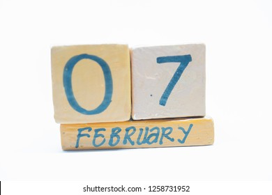 February 7th. Day 7 of month, handmade wood calendar isolated on white background. Winter month, day of the year concept