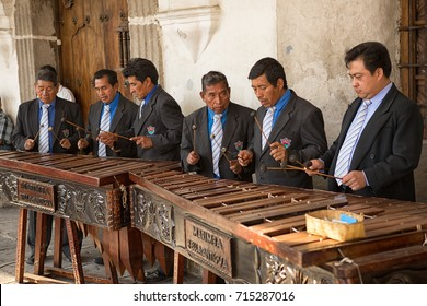February 8, 2015 Antigua, Guatemala: men marimba band playing in front of a colonial building