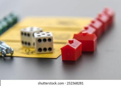 February 8, 2015 - Houston, TX, USA.  Monopoly pieces and Community Chest cards