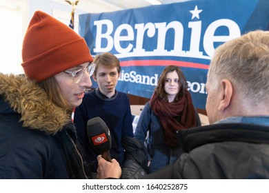 February 8, 2020, Dover, New Hampshire: Supporter of Bernie Sanders is being interviewed after candidate's vote canvass spee the vote canvass at Dover City Hall
