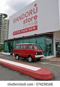 February 8th, 2017 - Selangor, Malaysia. An iconic old van decorated and placed besides used clothes store, Bandoru, a Japanese own company, located in Malaysia.