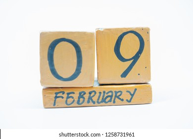 February 9th. Day 9 of month, handmade wood calendar isolated on white background. Winter month, day of the year concept