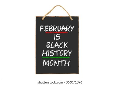 February is Black History Month mini blackboard sign isolated on white background