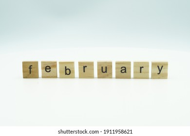 february word written on wood block. february text on table, concept.
