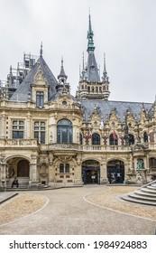 Fecamp, France - June 26, 2020: Architectural fragments of Benedictine Palace (Palais de la Benedictine, 1852) - neo-Gothic and neo-renaissance styles chateau.