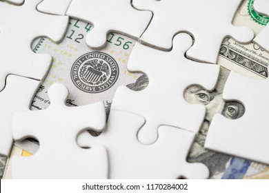 FED strategy of interest rate hike, United States of America financial or economics concept, jigsaw or puzzle reveals US Federal Reserve emblem and US ex president leader on dollars banknote.