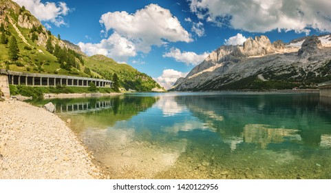 Fedaia lake among Dolomites Alps and mountain Marmolada with glacier on the right