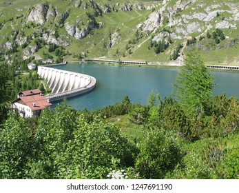 The Fedaia pass is an alpine pass formed by a plateau of about 2.5 kilometers, where there is an artificial lake, Lake Fedaia, lies at the foot of the Marmolada the highest mountain in the Dolomites