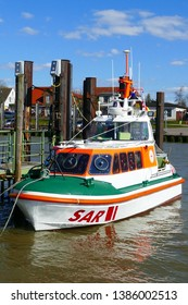 "Fedderwardersiel, Lower Saxony, Germany - April 10, 2019:  On the quay the ship ""Hermann Onken"" of the german sea rescue service"